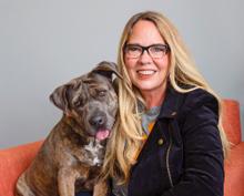 Julie Castle with brindle dog