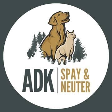 ADK Spay and Neuter (Hudson Falls, New York) logo drawn tan dog blonde cat surrounded by evergreens gray and gold lettering