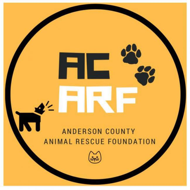 Anderson County Animal Rescue Foundation (Clinton, Tennessee) logo AC ARF in circle with pawprints and barking dog