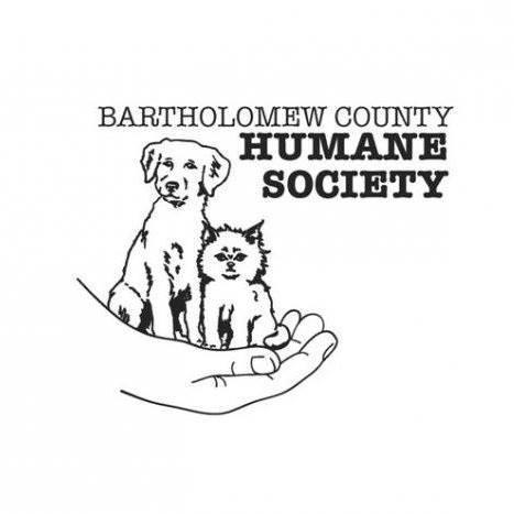 Bartholomew County Humane Society, Inc (Columbus, Indiana) logo with dog and cat in human hand