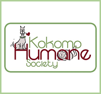 """Kokomo Humane Society (Kokomo, Indiana) logo is the org name with a cat with its head through the """"a"""" & a dog sitting on the """"H"""""""