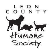 Leon County Humane Society (Tallahassee, Florida) logo is a dog, cat, and rabbit in between the words in the organization's name
