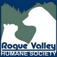 Rogue Valley Humane Society (Grants Pass, Oregon) logo is a white dog and cat facing each other in front of green mountains
