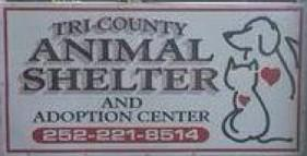 Tri-County Animal Shelter (Tyner, North Carolina) logo with dog and cat outlines on business sign
