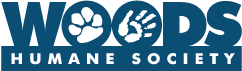 """Woods Humane Society (San Luis Obispo, California) logo is the org name with a pawprint and a hand in the o's in """"Woods"""""""